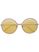 نظارة شمسية مستديرة من Gucci Eyewear